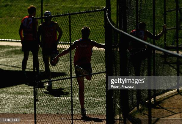 Players warm up during the Western Bulldogs AFL training session at Whitten Oval on March 20 2012 in Melbourne Australia