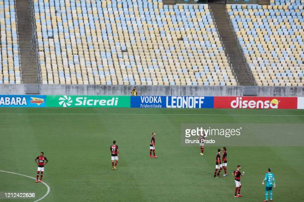 Players warm up in an empty stadium prior to a match between Flamengo and Potuguesa as part of the Rio State Championship 2020 to played behind...