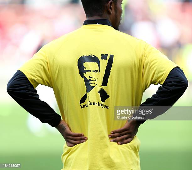Players warm up in Laurie Cunningham tshirts during the Sky Bet League One match between Leyton Orient and MK Dons at The Matchroom Stadium on...