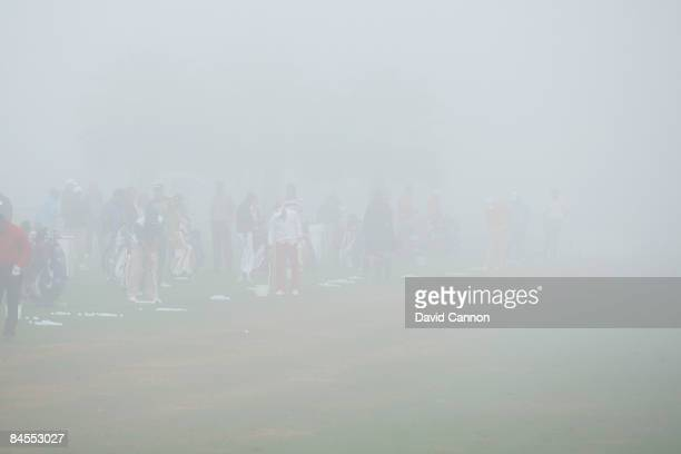 Players warm up in the fog that delayed the start by 3 three hours during the completion of the first round of the 2009 Dubai Desert Classic on the...