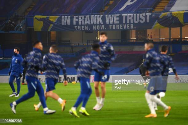 Players warm up in-front of a sign in the stands reads 'In Frank we trust' in reference to former Chelsea Manager Frank Lampard during the Premier...