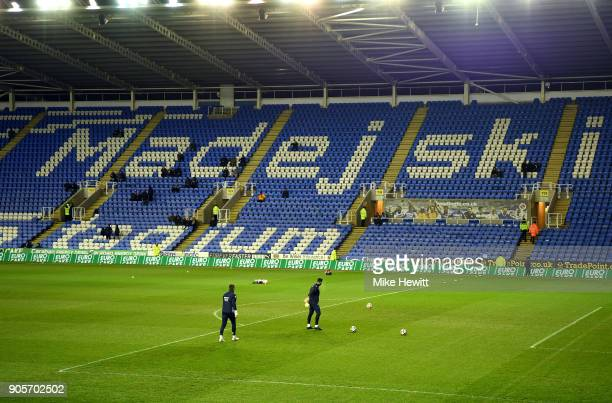 Players warm up infront of empty seats prior to The Emirates FA Cup Third Round Replay match between Reading and Stevenage at Madejski Stadium on...