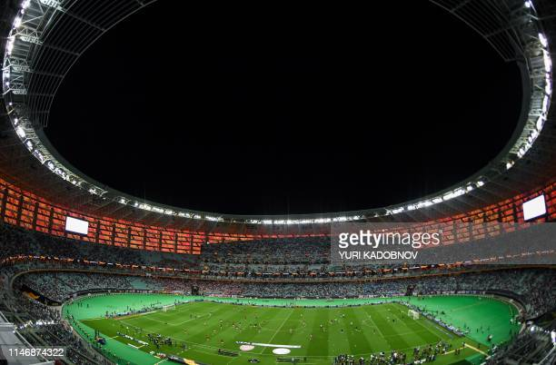 Players warm up on the pitch prior to the UEFA Europa League final football match between Chelsea FC and Arsenal FC at the Baku Olympic Stadium in...