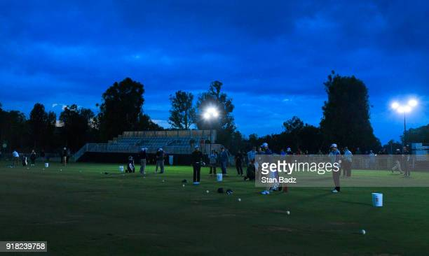 Players warm up under the lights on the driving range at sunrise during ProAm round for the Genesis Open at Riviera Country Club on February 14 2018...