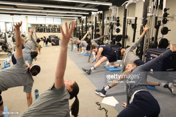 Players warming down and stretching under the supervision of strength coach Amanda Kimball during the The UConn Huskies women's basketball team...