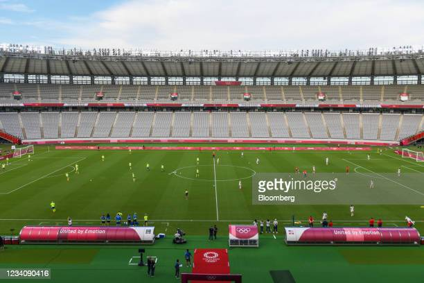 Players warm-up ahead of an opening round women's football match between the U.S. And Sweden at the Tokyo 2020 Olympic Games in Tokyo, Japan, on...
