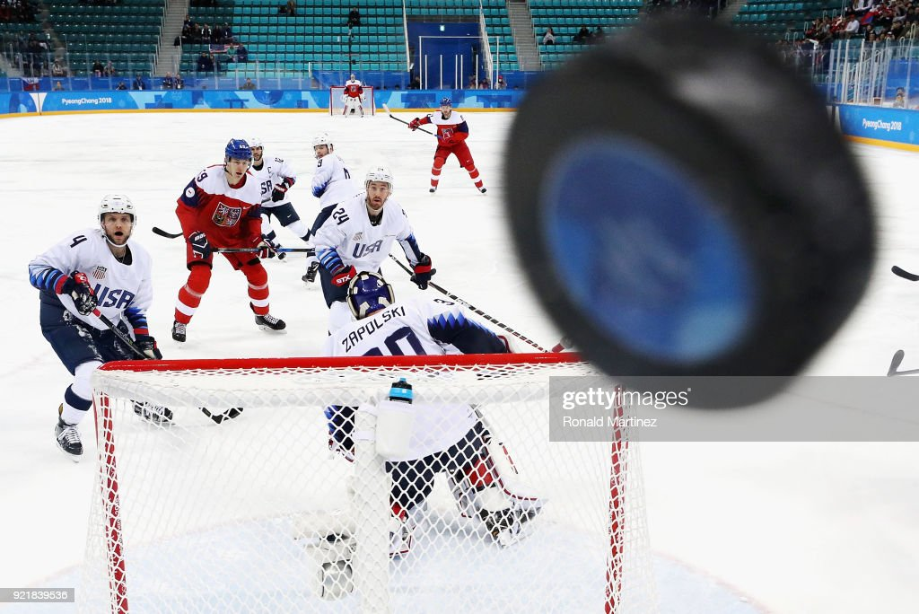 Players watch as the puck hits the glass in the first period of the Men's Play-offs Quarterfinals between the Czech Republic and the United States on day twelve of the PyeongChang 2018 Winter Olympic Games at Gangneung Hockey Centre on February 21, 2018 in Gangneung, South Korea.