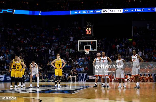 Players watch during a technical foul free throw during the game between the Virginia Cavaliers and the UMBC Retrievers in the first round of the...