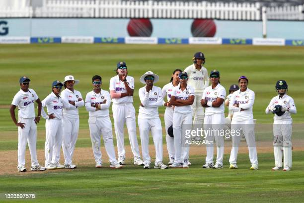 Players watch for the DRS decision on Day One of the LV= Insurance Test Match between England Women and India Women at Bristol County Ground on June...