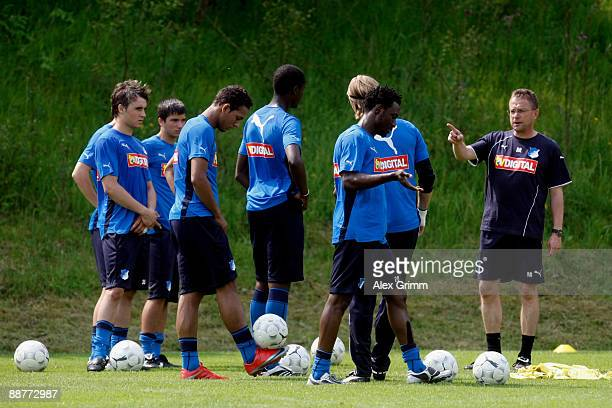Players watch head coach Ralf Rangnick gesture during a training session of 1899 Hoffenheim during a training camp on July 1, 2009 in Stahlhofen am...