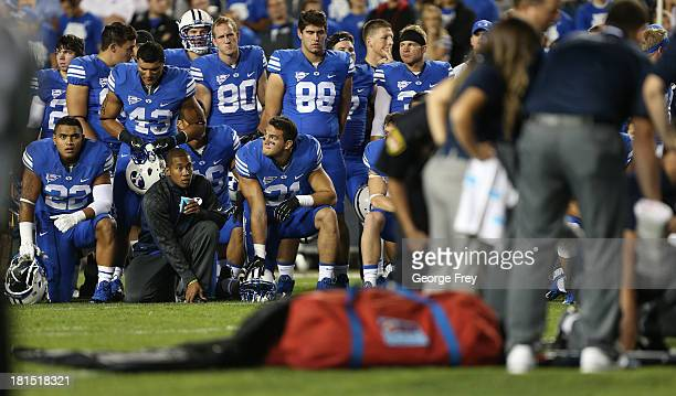 BYU players watche personal take care of their teammate Jamaal Williams of the BYU Cougars after he received a neck injury during a game against the...