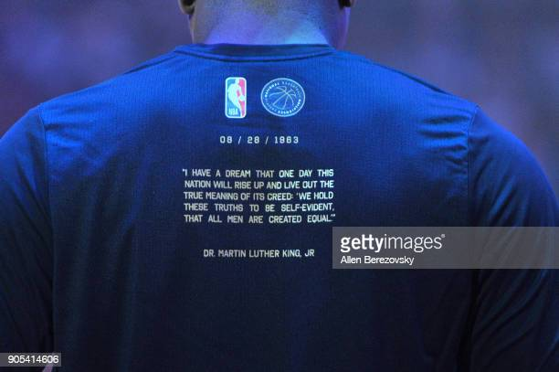 Players wear shirts quoting the 'I have a dream' speech by Dr Martin Luther King Jr before a basketball game between the Los Angeles Clippers and the...