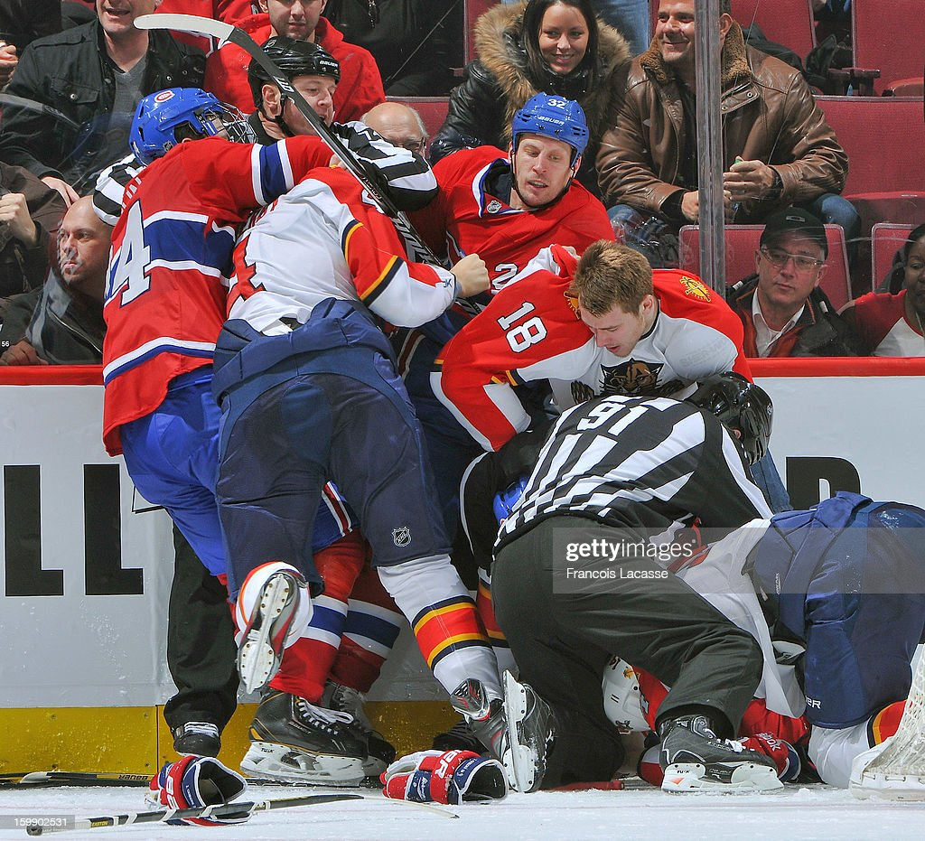 Players with the Montreal Canadiens and the Florida Panthers rough it up during the NHL game on January 22, 2013 at the Bell Centre in Montreal, Quebec, Canada.