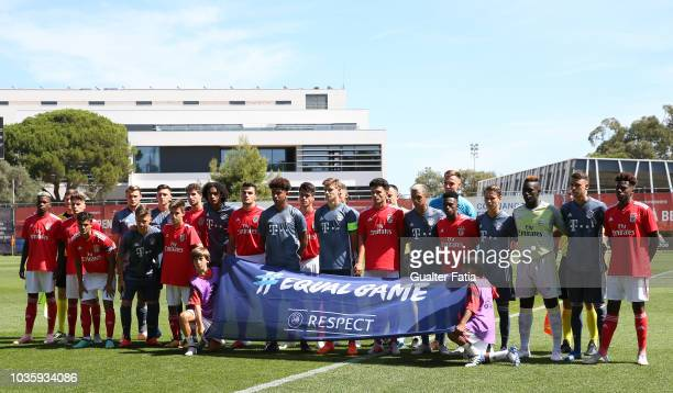 Players with the UEFA flag for Equal Game before the start of the UEFA Youth League match between SL Benfica and FC Bayern Munchen at Caixa Futebol...