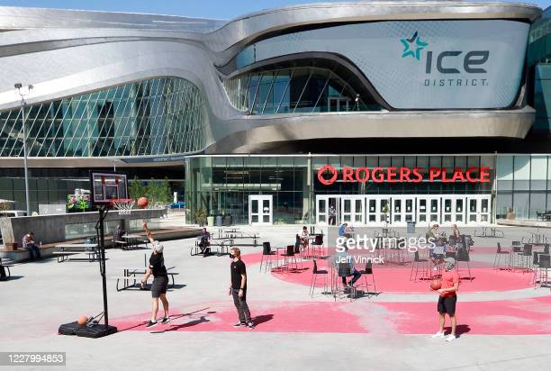 Players with the Vegas Golden Knights wear protective face masks as they play basketball in the recreation area outside Rogers Place on August 10,...