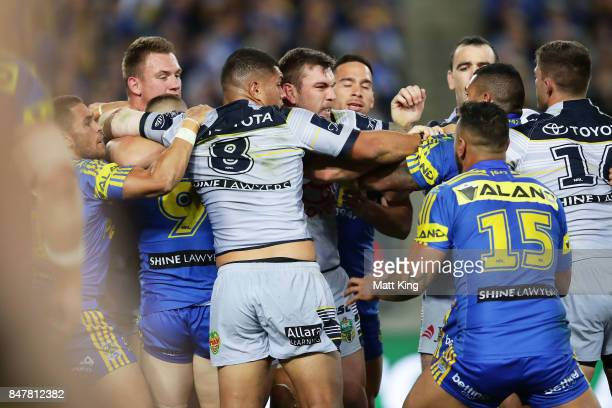 Players wrestle after the try to Coen Hess of the Cowboys during the NRL Semi Final match between the Parramatta Eels and the North Queensland...