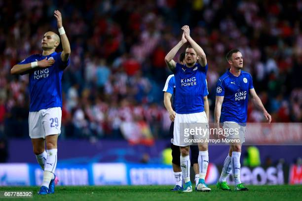 Players Yohan Benalouane and Jamie Vardy of Leicester City FC acknowledge their fans after the UEFA Champions League Quarter Final first leg match...