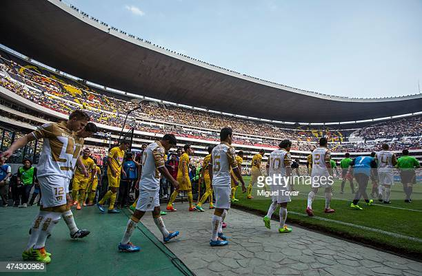 Playes of America and Pumas entering the field during a match between America and Pumas UNAM as part of the Clausura 2014 Liga MX at Azteca Stadium...