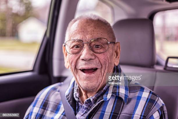 Playful 94 Year Old Grandpa Portrait in the Car