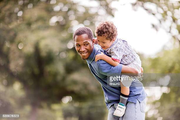 Playful African American father and son.