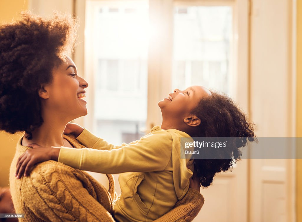 Playful African American mother and daughter having fun at home. : Stockfoto