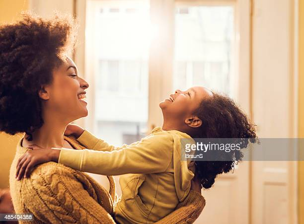 playful african american mother and daughter having fun at home. - african american family home stock photos and pictures