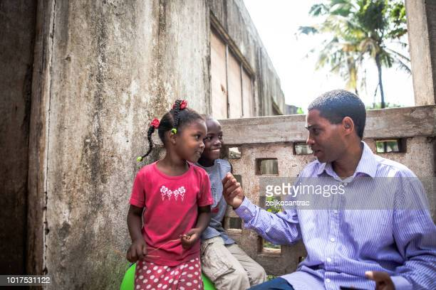 playful african  little child having fun with father outdoors - east africa stock photos and pictures
