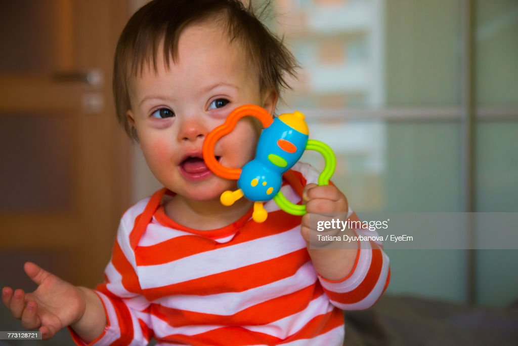 Playful Baby Boy Sitting On Bed At Home : Stock Photo