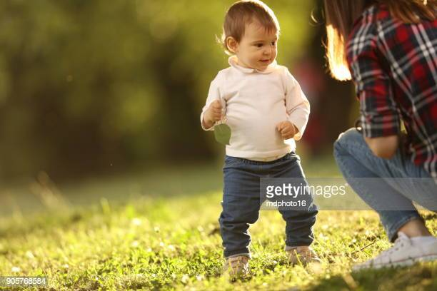 playful baby in the park - bent over babes stock pictures, royalty-free photos & images