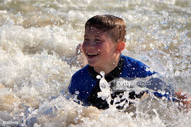 Playful Boy Swimming In Sea