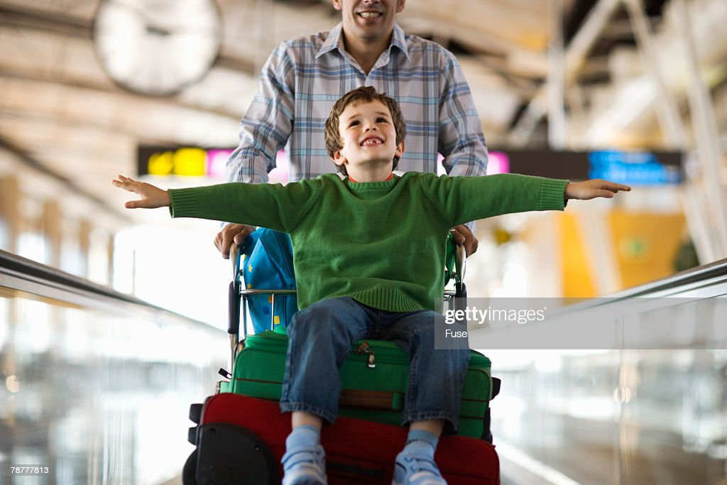 Playful Boy With Father at Airport Terminal : Stock Photo
