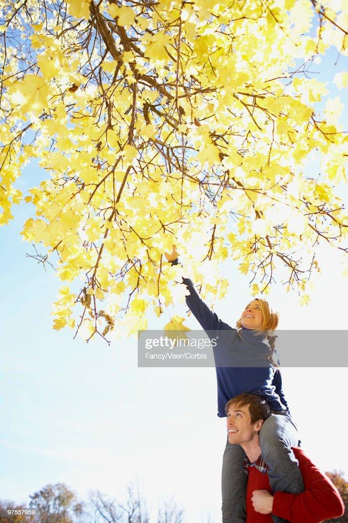 Playful boyfriend and girlfriend outdoors : Stock Photo