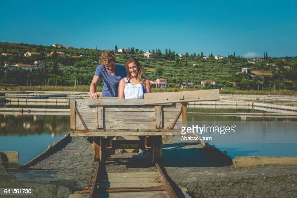 Playful Caucasian Couple Enjoying the Salt Pans,  Portorose, Slovenia, Europe