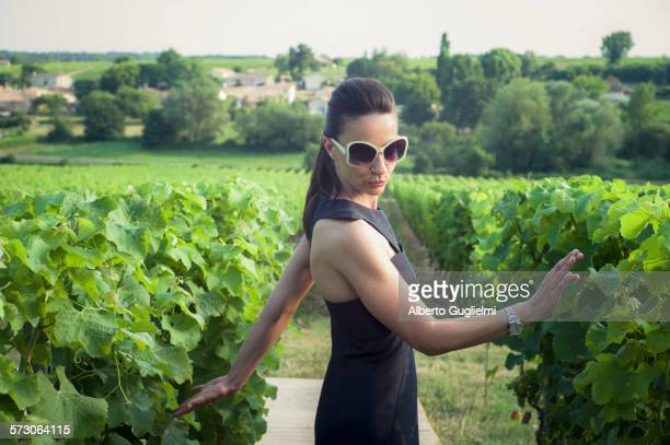 playful caucasian woman in vineyard - gironde stock pictures, royalty-free photos & images