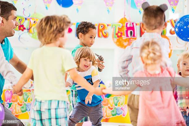 playful children at birthday party. - preschool student stock pictures, royalty-free photos & images