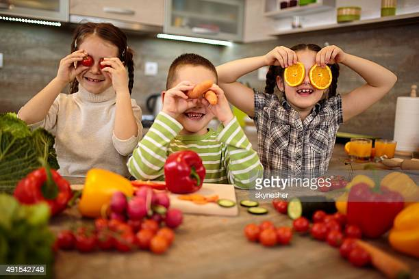 Playful children having fun in the kitchen.