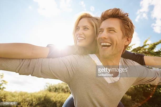 Playful couple enjoying outdoors