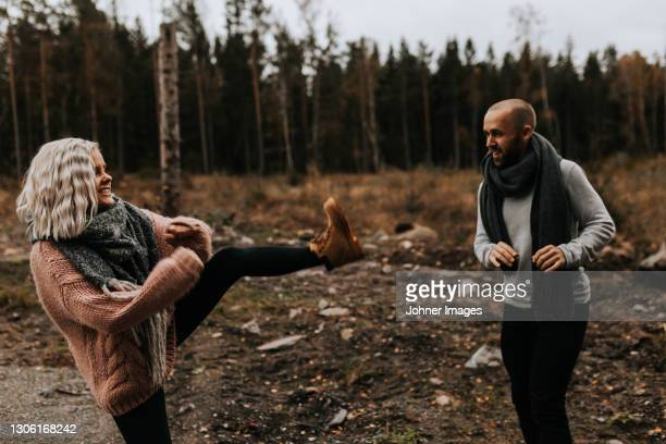 playful couple fighting - västra götaland county stock pictures, royalty-free photos & images