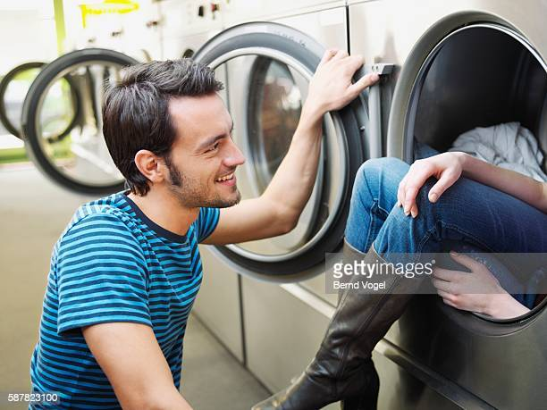 Playful Couple Flirting at Laundromat
