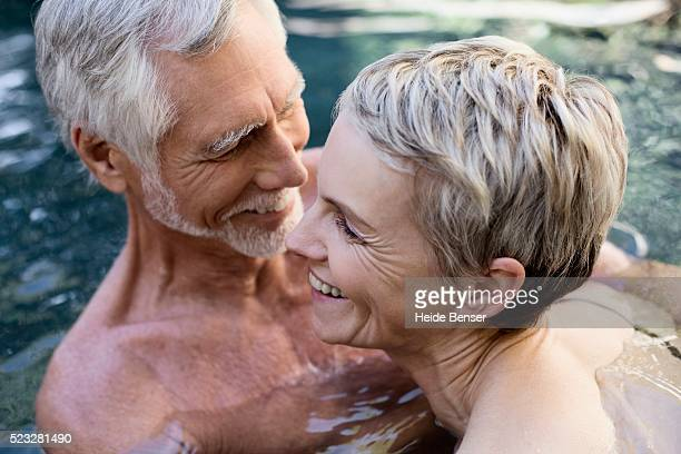 Playful couple in a pool