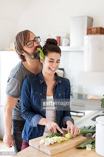 Playful couple in kitchen