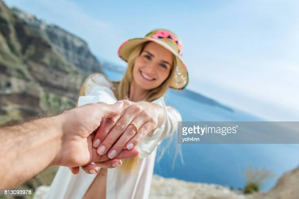 playful couple in love - man holding engagement ring stock photos and pictures