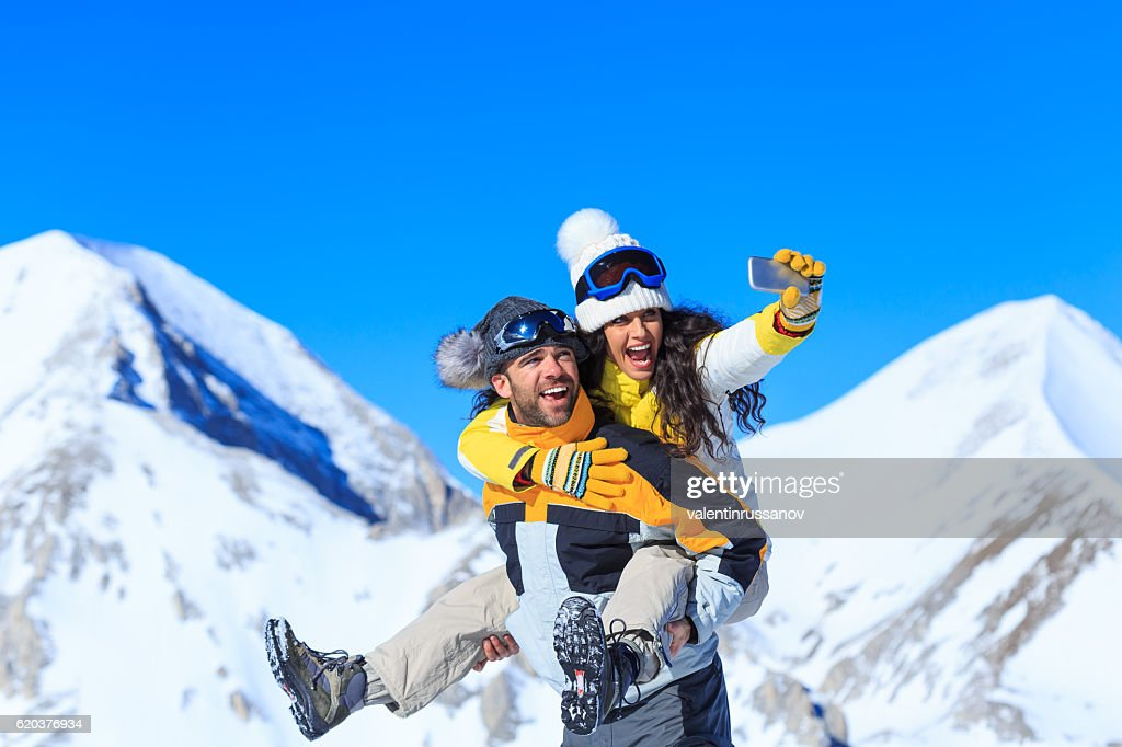 Playful Couple Making Selfie On Top Snow Mountain Stock Photo ... 8493c6473
