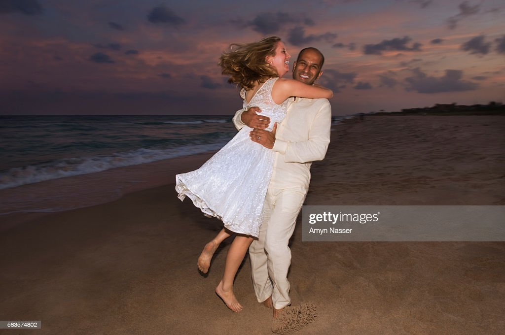 Playful Couple on Beach : Stock Photo