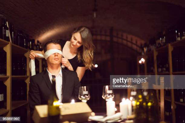 playful couple tasting wine blindfolded - love is blind stock pictures, royalty-free photos & images