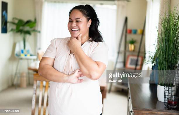 Playful expression of Maori woman.