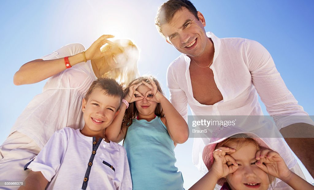 Playful family against the sky. : Stock Photo