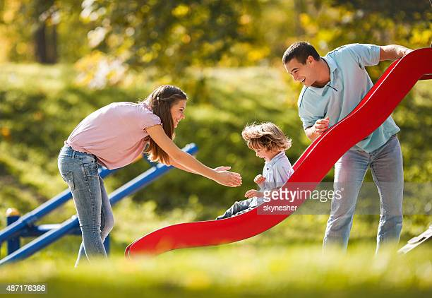 Playful family enjoying in the playground.