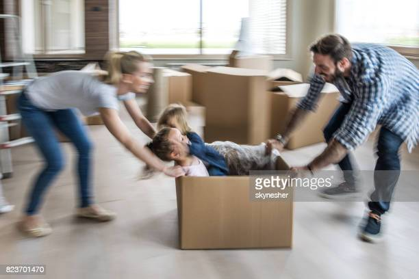 playful family having fun after relocation in new home. blurred motion. - penthouse girls stock pictures, royalty-free photos & images