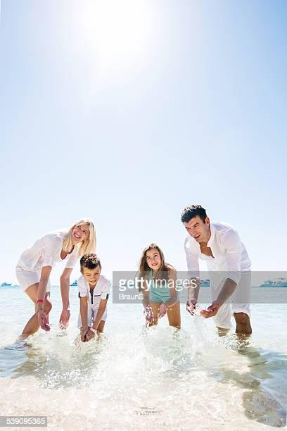Playful family having fun in the sea.